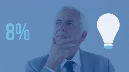male : Animation of senior Caucasian thoughtful man with light bulb shape and percent increasing from zero to seventy three filling in blue on blue background Stock Footage