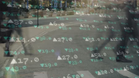 büyüme : Animation of people crossing a street with financial data moving in the foreground Stok Video