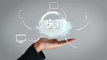 scanning : Animation of 5g displayed in a rotating circle with person holding it and network links with icons appearing in the foreground Stock Footage