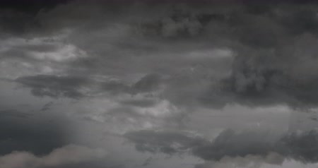 gloomy sky : Digital animation of Dark Stormy Sky with rain and clouds with copy space 4k