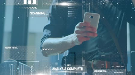 phone entertainment : Animation of scanning and processing data with a young Caucasian man using a smartphone and drinking coffee in the background Stock Footage