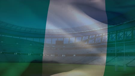 nigeria flag : Animation of a blowing Nigerian flag in front of a sports stadium Stock Footage