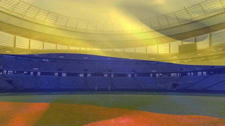 Колумбия : Animation of a blowing Colombian flag in front of a sports stadium