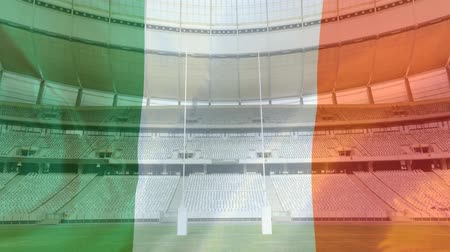 antecipação : Animation of a blowing Italian flag in front of a sports stadium