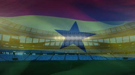 antecipação : Animation of a blowing flag of Ghana in front of a sports stadium
