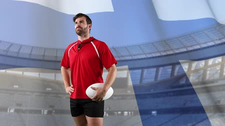 rugby shirt : Animation of a Caucasian male rugby player holding a ball and looking around with blowing Finnish flag and stadium in the background