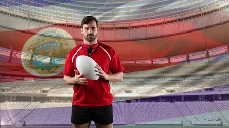 rúgbi : Animation of a Caucasian male rugby player playing with a ball and looking to camera with blowing Costa Rican flag and stadium in the background