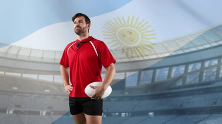 antecipação : Animation of a Caucasian male rugby player holding a ball and looking around with blowing Argentinian flag and stadium in the background