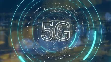 light display : Animation of 5G displayed on a rotating globe with abstract graphic appearing and with cityscape in the background Stock Footage