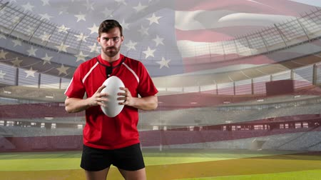 antecipação : Animation of a Caucasian male rugby player pointing with a ball and looking to camera with blowing American flag and stadium in the background