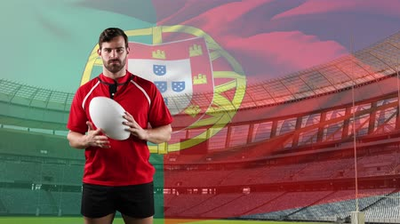 rúgbi : Animation of a Caucasian male rugby player playing with a ball and looking to camera with blowing Portuguese flag and stadium in the background