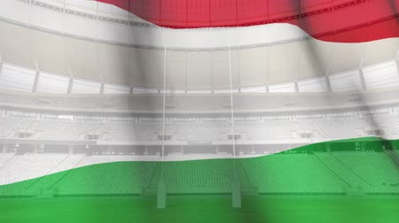 tournament : Animation of a blowing Hungarian flag in front of a sports stadium