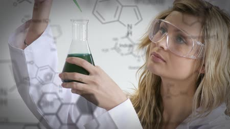 pathology : Animation of a young Caucasian female scientist in a laboratory with white structural formula of chemical compounds in the foreground