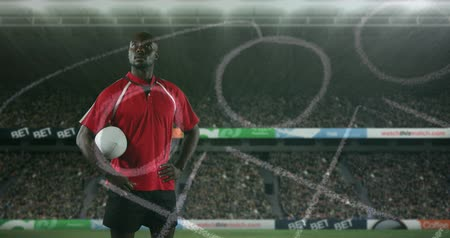 rugby ball : Animation of an African American male rugby player standing, holding a ball under his arm and looking around with hand drawn game plan in the foreground and sports stadium in the background 4k