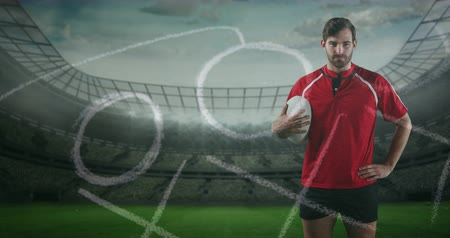 antecipação : Animation of a Caucasian male rugby player standing, holding a ball in his hand and looking to camera with hand drawn game plan in the foreground and sports stadium in the background 4k