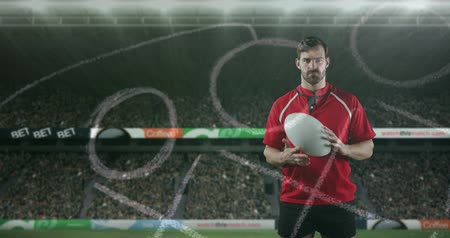 rugby shirt : Animation of a Caucasian male rugby player standing, playing with a ball and looking to camera with hand drawn game plan in the foreground and sports stadium in the background 4k