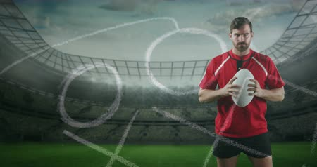 antecipação : Animation of a Caucasian male rugby player standing, playing with a ball and looking to camera with hand drawn game plan in the foreground and sports stadium in the background 4k