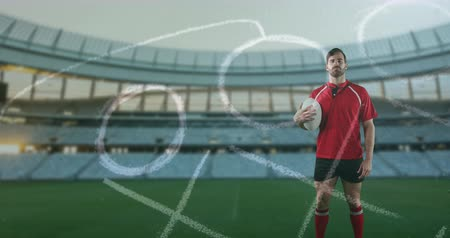 rúgbi : Animation of a Caucasian male rugby player standing, holding a ball in his hand and looking to camera with hand drawn game plan in the foreground and sports stadium in the background 4k