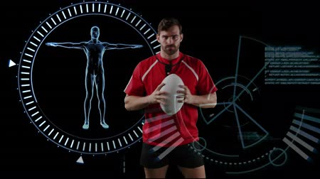 rugby shirt : Animation of a Caucasian male rugby player playing with a ball and looking to camera with human model spinning in a circle and data appearing on black background Stock Footage