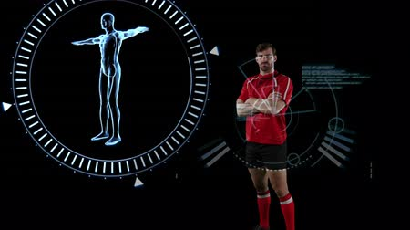 rugby shirt : Animation of a Caucasian male rugby player standing with crossed arms and looking to camera human model spinning in a circle and data appearing on a black background Stock Footage