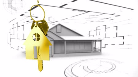 mülkiyet : Animation of golden house keys and house shaped key fob hanging with house model and architectural drawing in the background Stok Video