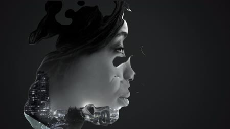 distorcida : Animation of a side view of the face of a young African American woman distorted by moving liquid with cityscape on black background
