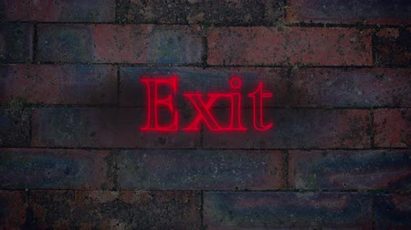 way out : Animation of letters of the Exit red neon sign appearing on brick wall background Stock Footage
