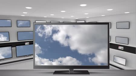 egy sorban : Animation of blue sky and clouds displayed on a television screen with a bank of television screens in a store in the background