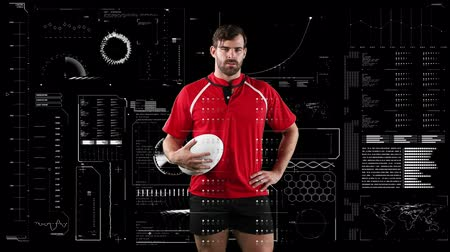 rugby shirt : Animation of a Caucasian male rugby player holding a ball and looking to camera with data processing on a black background