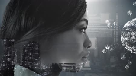 social change : Animation of a globe spinning with data processing and connection network with a side view of the face of a young African American woman and cityscape on a black background