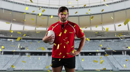 rugby shirt : Animation of a Caucasian male rugby player playing with a ball and looking to camera with golden confetti falling and a sports stadium in the background