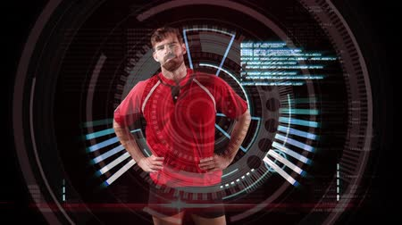 rugby shirt : Animation of an Caucasian male rugby player standing with his hands on hips and looking to camera with circles spinning and medical data appearing on a black background