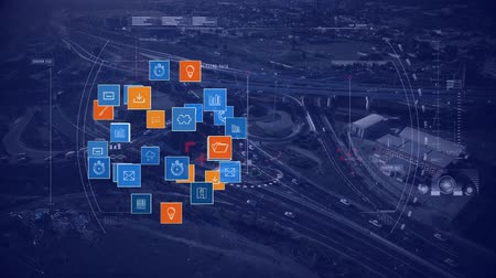 social change : Animation of blue and orange computer and networking icons appearing and growing with road network in the background