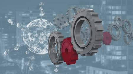 futuristic concept : Animation of red cogs joining cogs rotating while a globe is spinning with data and connection network and cityscape in the background Stock Footage