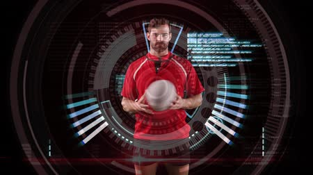 rugby shirt : Animation of a Caucasian male rugby player playing with a ball and looking to camera with circles spinning and medical data appearing on a black background