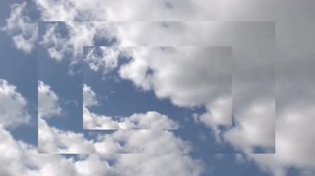derűs : Animation of rolling white clouds in a blue sky on three overlaid screens of diminishing size
