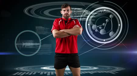 scanning : Animation of a Caucasian male rugby player standing with crossed arms and looking to camera with medical data appearing on a dark blue background