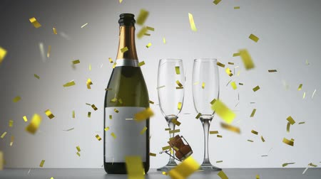 champagne flute : Animation of a close up of a champagne bottle and two glasses with golden confetti falling on a white background Stock Footage