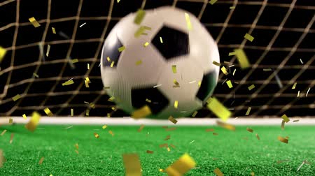 antecipação : Animation of a close up of a football bouncing on a football pitch in front of a goal with golden confetti falling