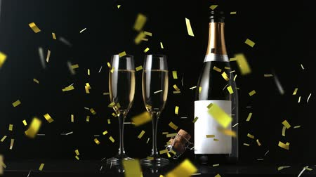 champagne flute : Animation of a close up of a cork shooting up from a champagne bottle with two glasses and golden confetti falling on a black background