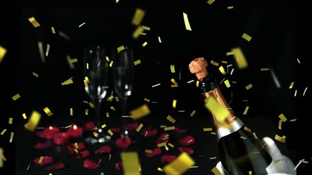 захватывающий : Animation of a close up of a cork shooting up from a champagne bottle with two glasses and rose petals and golden confetti falling on a black background