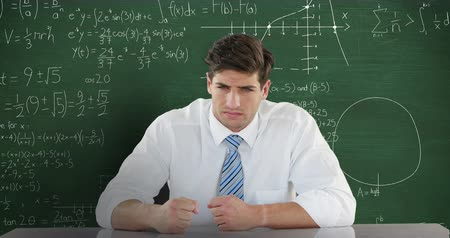 matemático : Animation of angry Caucasian man sitting in front of chalkboard with moving mathematical graphs and formulae written in chalk Stock Footage