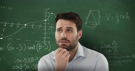 formulae : Animation of confused Caucasian man seen in head and shoulders view looking up in front of blackboard with moving mathematical graphs and formulae written in chalk Stock Footage