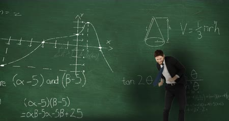 matemático : Animation of a young Caucasian man celebrating in front of moving mathematical graphs and formulae written in chalk on a blackboard Stock Footage