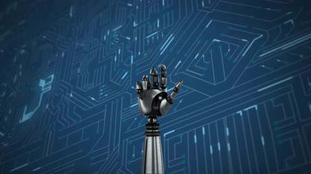 układ scalony : Animation of metal robot hand turning and clenching fist over a computer circuit board, glowing with light trails on a blue background
