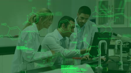 pathology : Animation of Caucasian male and female scientists working together in a laboratory using laptop, with glowing green data and structural formula of chemical compounds in the foreground