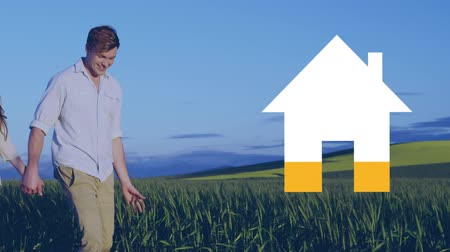 hodnocení : Animation of house shape filling in yellow with close up of young Caucasian couple walking in a field in the background Dostupné videozáznamy