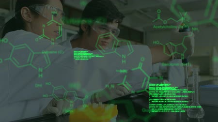 pathology : Animation of a close up of male and female scientists in protective clothes working in a laboratory, with glowing green data and structural formula of chemical compounds in the foreground