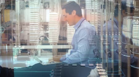 сосредоточиться на переднем плане : Animation of a side view of a happy Caucasian man using a laptop and sitting on the floor of a computer server room, while a computer motherboard moves in the foreground