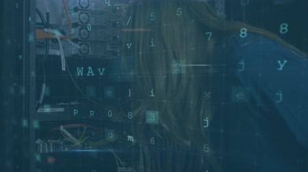 concentrando : Animation of a close up side view of a Caucasian woman working in a computer server room, with data security warning messages in the foreground